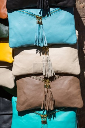 Brightly coloured leather bags for sale in San Gimignano, Italy