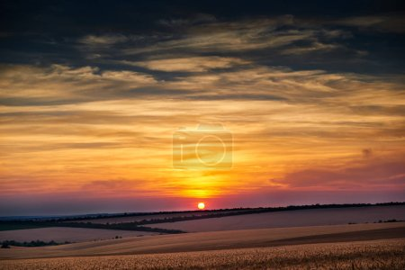 Photo for Beautiful sunset and sky in the field as background, colorful clouds - Royalty Free Image