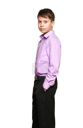 Photo for Boy posing on white background, black trousers and purple shirt - Royalty Free Image