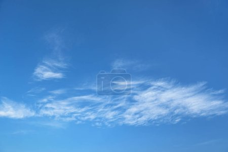 beautiful blue sky with soft white clouds, abstract background