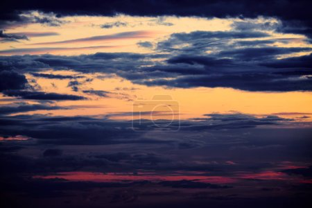 Photo for Beautiful sunset - dark sky with clouds and sunlight - Royalty Free Image