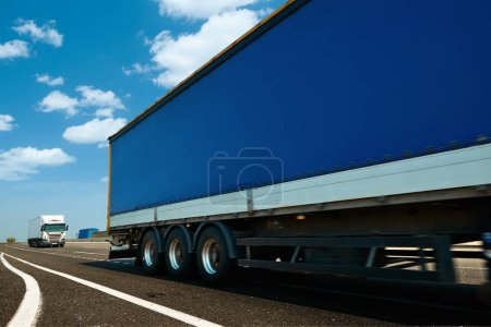 Photo for Commercial delivery cargo truck on highway traffic - Royalty Free Image