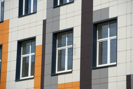 Photo for Facade of a modern building on a bright Sunny day, siding and Windows, beautiful exterior of the new building - Royalty Free Image
