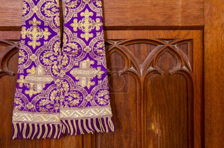 Purple priest stole used for confessions, vestment purple and gold as worn during confession and mass.