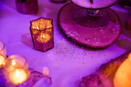 Photo for Snow Flakes Wedding Table Decoration with Candle in Purple Lighting - Royalty Free Image