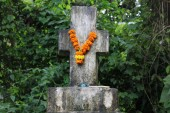 A cross venerated in Indian garland style with flowers, as found in Goa.