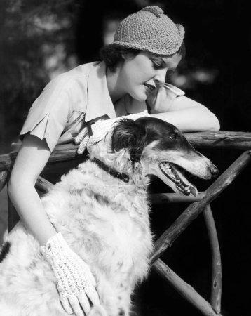 Woman petting her Borzoi