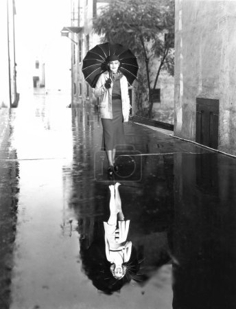 Reflection of a woman in a puddle