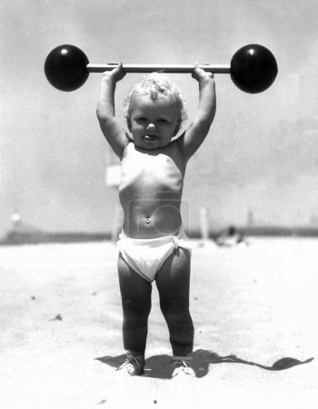 Baby weight lifter on the beach