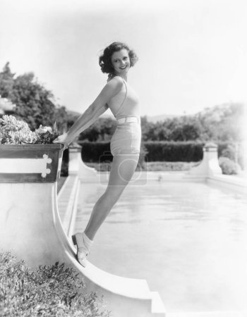 Bathing beauty posing by the pool