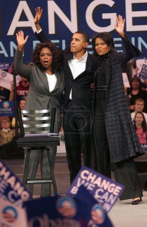Photo for Oprah Winfrey, Barack Obama, Michelle Obama in attendance for Barack Obama Campaign Rally for Democratic Presidential Primary with Oprah Winfrey, The Verizon Wireless Arena, Manchester, NH, December 09, 2007. Photo by: Kristin Callahan/Everett Collec - Royalty Free Image