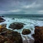 Long exposure shot of powerful waves crashing into...
