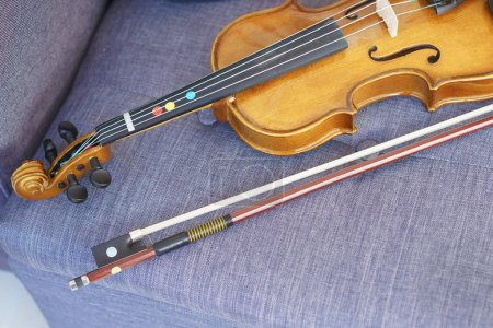 Violin and bow lie on surface