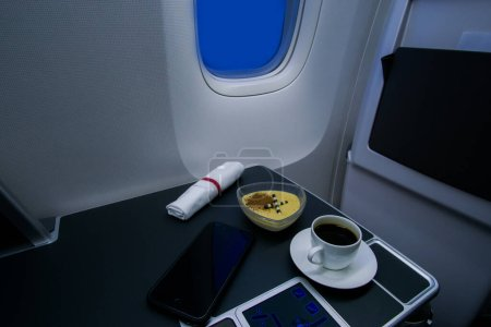 Photo for Coffee and dessert served on board of business class airplane - Royalty Free Image