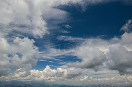Photo for View of fluffy clouds on vivid blue sky, cloudscape - Royalty Free Image
