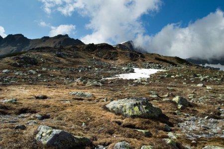snowcapped mountainous landscape under blue cloudy sky