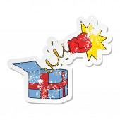 distressed sticker of a trick present with boxing glove