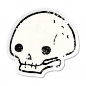 distressed sticker of a cartoon spooky skull