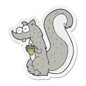 sticker of a cartoon squirrel with nut