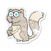 retro distressed sticker of a cartoon angry squirrel with nut