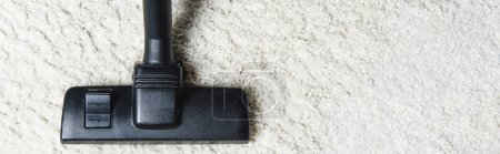 Photo for Top view of white carpet and vacuum cleaner, close-up view - Royalty Free Image