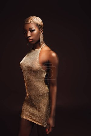 Photo for Stylish african american woman with short hair isolated on brown - Royalty Free Image
