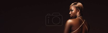 Photo for Glamorous trendy african american woman with short hair isolated on brown - Royalty Free Image