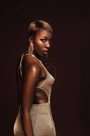 Foto de Fashionable african american woman with short hair isolated on brown - Imagen libre de derechos