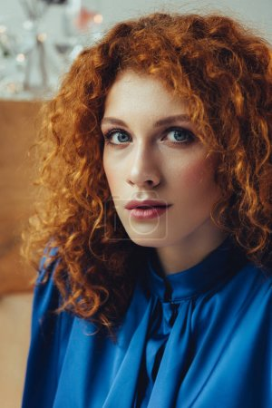 Photo for Selective focus of attractive stylish redhead young woman looking at camera - Royalty Free Image
