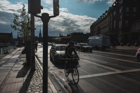 Photo for COPENHAGEN, DENMARK - APRIL 30, 2020: Urban street with road, facades of buildings and cloudy sky at background - Royalty Free Image
