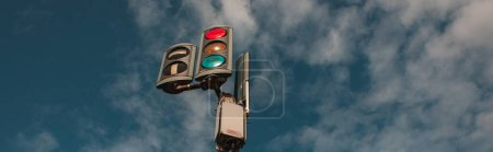 Photo for Panoramic shot of traffic lights with cloudy sky at background - Royalty Free Image