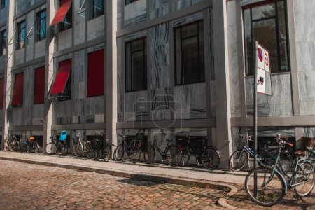 Photo for Bicycles near facade of building and walkway in Copenhagen, Denmark - Royalty Free Image