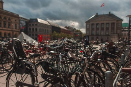 Photo for Selective focus of bicycles with sunlight on urban street in Copenhagen, Denmark - Royalty Free Image