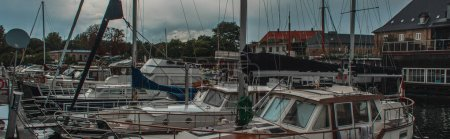 Photo for Horizontal image of docked yachts in harbor with cloudy sky at background in Copenhagen, Denmark - Royalty Free Image