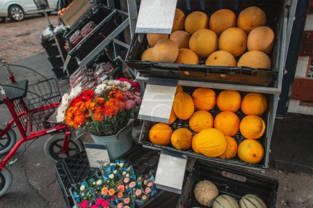 Photo for Melons and flower bouquets on shop showcase on urban street in Copenhagen, Denmark - Royalty Free Image
