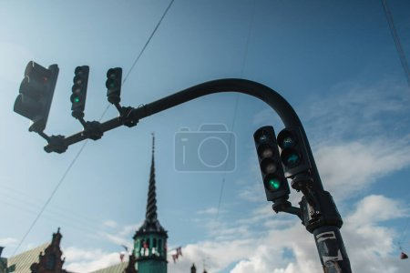 Photo for Low angle view of traffic lights with cloudy sky at background on urban street in  Copenhagen, Denmark - Royalty Free Image