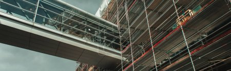 Photo for Panoramic orientation of building construction with glass corridor and cloudy sky at background, Copenhagen, Denmark - Royalty Free Image