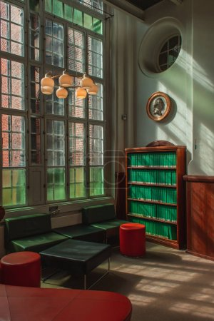 Photo for Vintage interior of living room with books in wooden cupboard, Copenhagen, Denmark - Royalty Free Image
