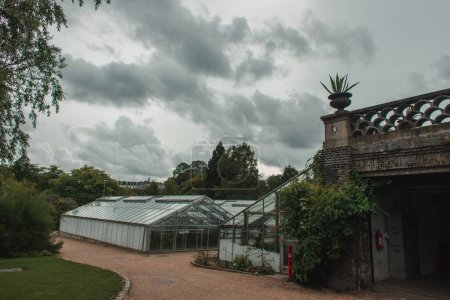 Photo for Greenhouses and botanical garden with cloudy sky at background in Copenhagen, Denmark - Royalty Free Image