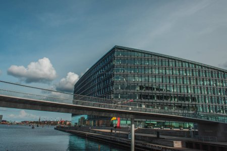 Photo for Bridge above river with building and blue sky with clouds at background in Copenhagen, Denmark - Royalty Free Image