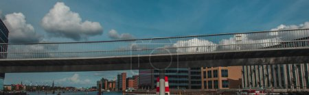 Photo for Panoramic shot of bridge with buildings and cloudy sky at background in Copenhagen, Denmark - Royalty Free Image
