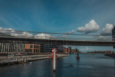 Photo for Bridge above canal with urban street and cloudy sky at background in Copenhagen, Denmark - Royalty Free Image