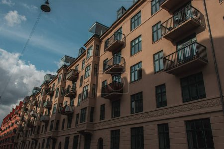 Photo for Low angle view of facade of house with cloudy sky at background, Copenhagen, Denmark - Royalty Free Image