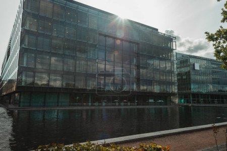 Photo for Glass facade of building near canal in Copenhagen, Denmark - Royalty Free Image