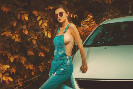 Photo for Hot Sexy brunette posing near the car in th autumn - Royalty Free Image
