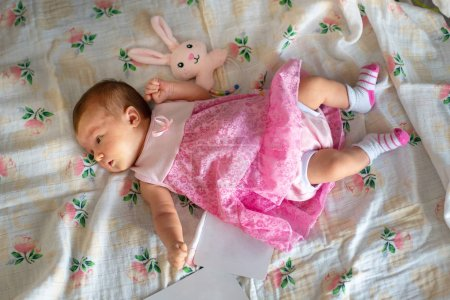 Photo for Adorable newborn baby girl in pink dress - Royalty Free Image