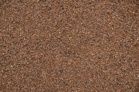 Horizontal background texture of red granite chips...