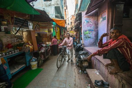 VARANASI, INDIA - MAR 23, 2018: One of the many narrow streets in the old city center. According to the legend of Varanasi was founded about 5000 years ago by God Shiva.