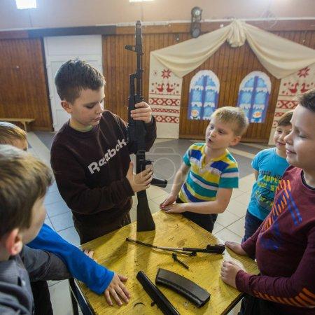NIKOLSKY, RUSSIA - JAN 19, 2018: Training of children to use weapons in the framework of revival program of the Cossacks in the Leningrad region. Cossacks in St.Petersburg began its revival in 1990.