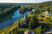 Top view of Vazhinka river and Church of St. Nicholas (built 1696) in Soginicy village, Leningrad region, Russia.